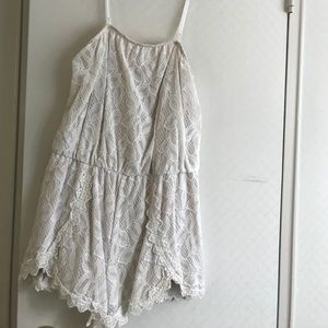 White free people romper with removal straps